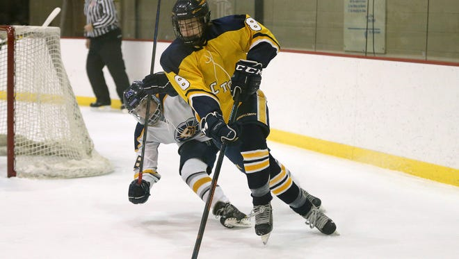 Victor's Connor Gilbert (8) carries the puck around his net with Brighton/HFL's Andrew Mapstone pressuring.
