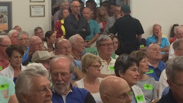 An overflow crowd  jammed Bonita City Hall and its parking lot Wednesday, as the city council rejected the proposal for four 22-story towers at the site of the Raptor Bay golf course. The council rejected taking the first of several steps needed to approve the towers.