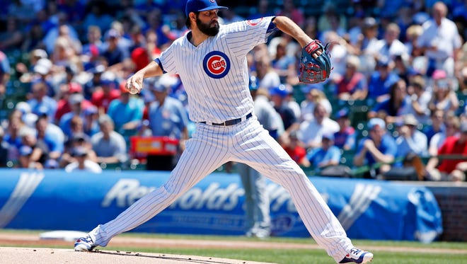 Chicago Cubs starter Jason Hammel throws against the Texas Rangers on July 16. Hammel credits his success in the start to the addition of potato chips in his diet.