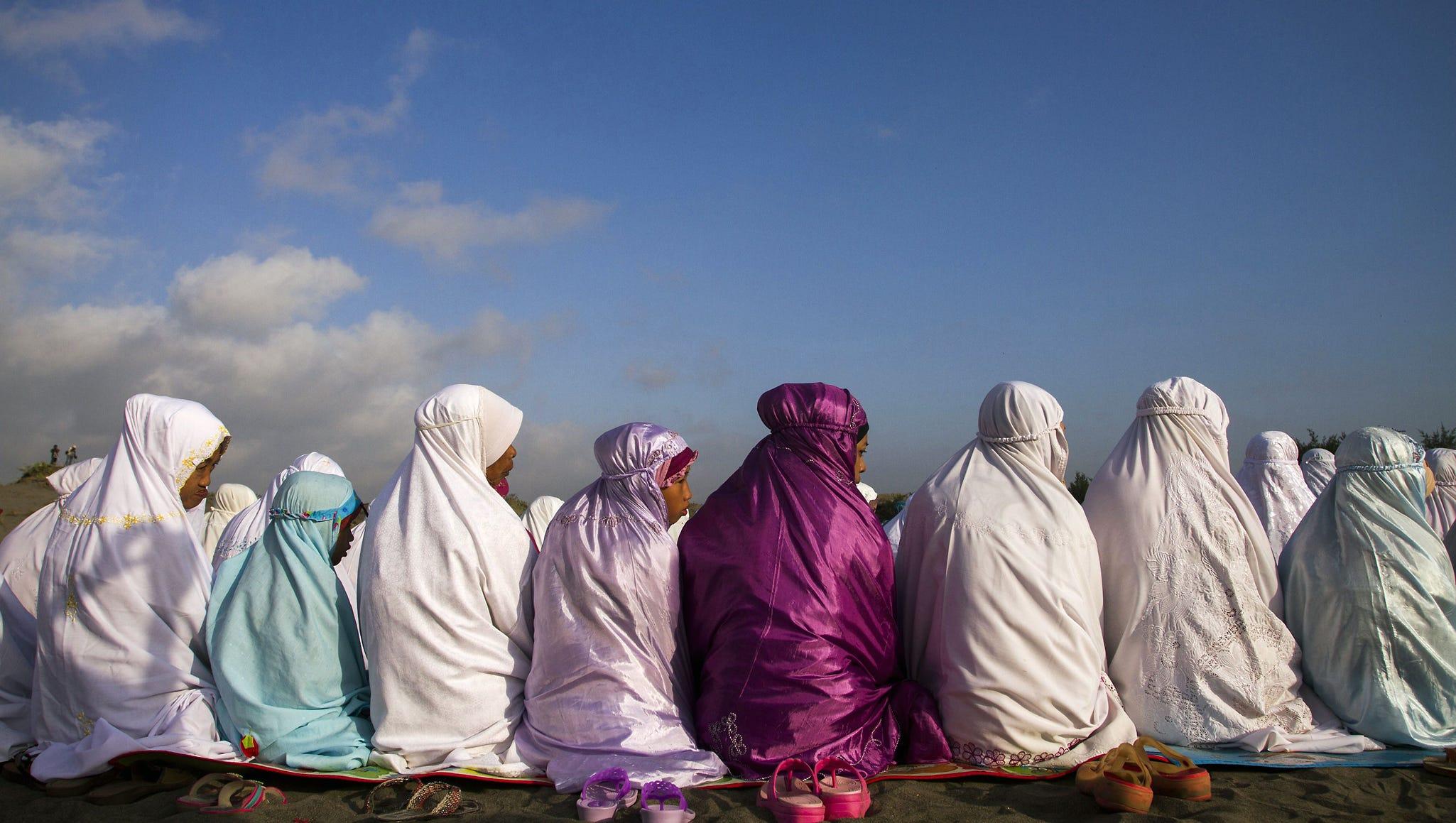 Indonesian Muslims attend early morning Eid al-Fitr prayers near the coast in Bantul, Yogyakarta, in central Java island on Aug. 8.
