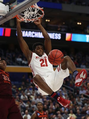 UW's Khalil Iverson (pictured dunking in the NCAA Tournament last season) aimed to improve his shooting and ball-handling and to become more assertive offensively.