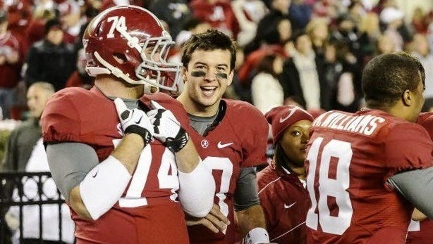 Former Alabama offensive tackle Caleb Gulledge, here with A.J. McCarron, is now playing for Faulkner.