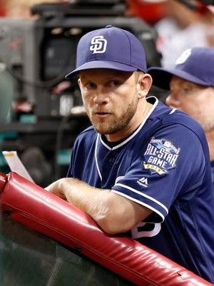 San Diego Padres manager Andy Green watches from the dugout during the eighth inning against the Cincinnati Reds at Great American Ball Park. The Padres won 13-4.