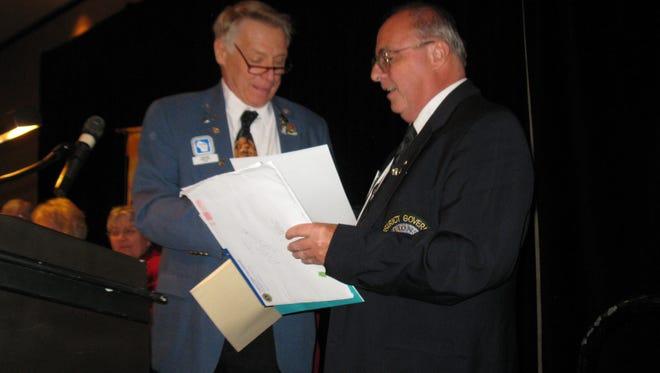 Tom King, left, presents Gary Silah with the Birch-Sturm Fellowship.