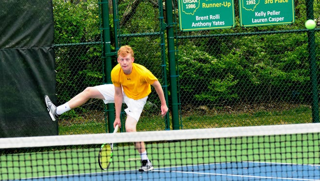 Sycamore's Matt Bolger delivers a powerful serve in the Flight B, 2nd Doubles of the Coaches Classic,  April 30, 2016.