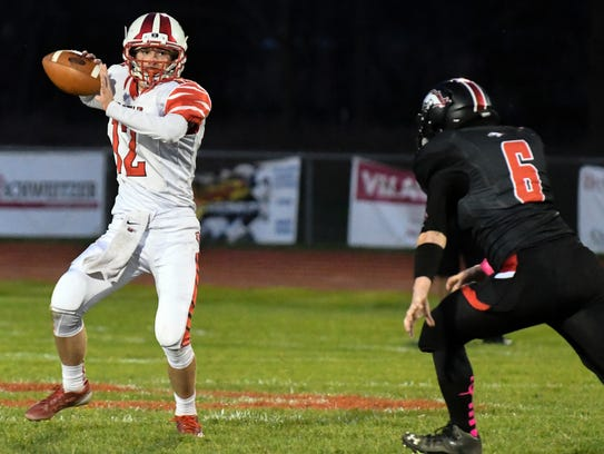 St. Philip QB Conor Gausselin (12) drops back to pass