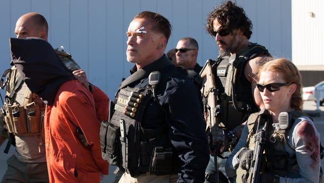 Arnold Schwarzenegger (from left), Joe Manganiello and Mireille Enos from the film 'Sabotage.'