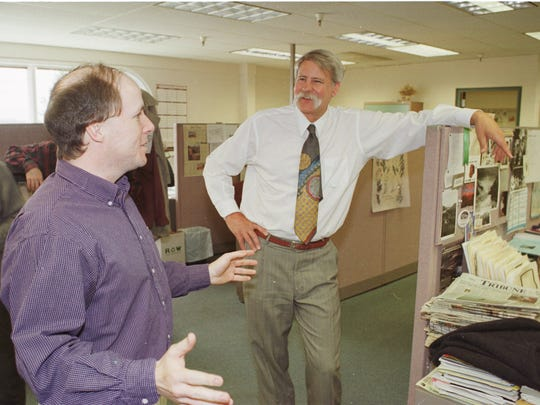 """Tribune Editor Jim Strauss and Projects Editor Eric Newhouse in the Tribune newsroom after receiving word that Newhouse had won the Pulitzer Prize for explanatory reporting for the yearlong series, """"Alcohol: Cradle to Grave."""""""
