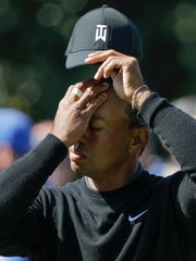 Tiger Woods reacts on the first green during the first