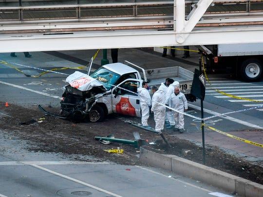 Investigators inspect a truck following a shooting