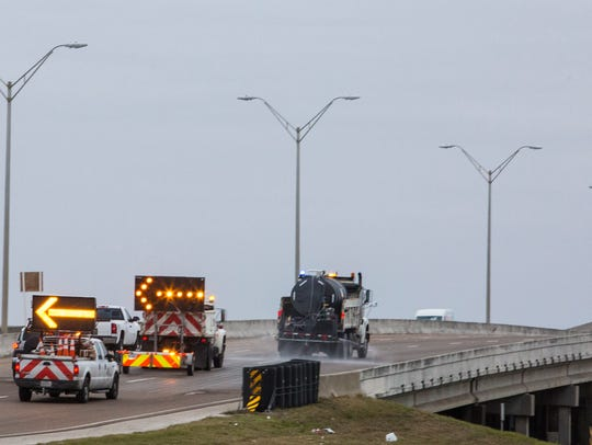 Transportation department work crews prepare the Nueces Bay Causeway for the freezing temperatures Tuesday, Jan. 2, 2018.