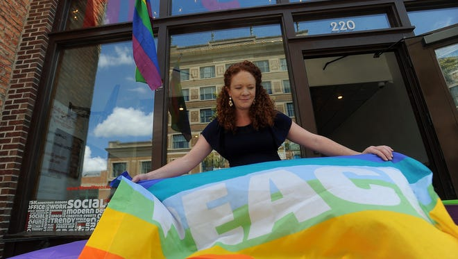 Heather Smith with the ACLU decorates with balloons as part of a local celebration in downtown Sioux Falls for the Supreme Court's decision to legalize same-sex marriage in all 50 states on Friday, June 26, 2015.