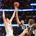 Mar 25, 2016; Chicago, IL, USA; Syracuse Orange forward Tyler Lydon (20) blocks the shot of Gonzaga Bulldogs guard Josh Perkins (13) during the second half in a semifinal game in the Midwest regional of the NCAA Tournament at United Center. Mandatory Credit: David Banks-USA TODAY Sports
