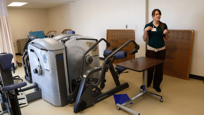 Physical therapist assistant Kelsie Garcia talks about the workout equipment in the new therapy room Thursday at the Good Samaritan Society Four Corners Village in Aztec.