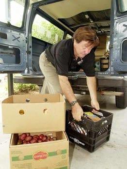 Jesse Zermeno, President of Operation Hope, unloads the van full of food, clothing, toys.