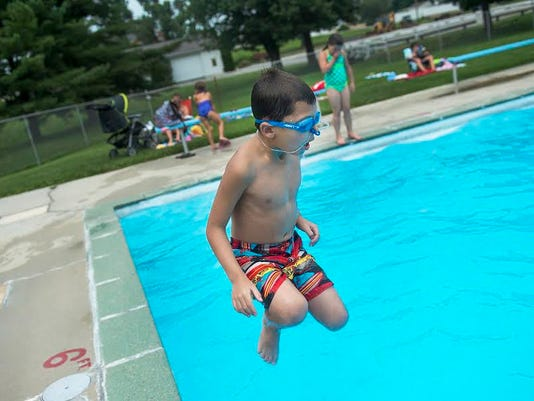 Corey Williams, 9, jumps in the pool at Neiderer's in McSherrystown on Tuesday. Corey's dad, Tim Williams, said the family has a season pass for the summer and they usually head to the pool two to three times per week.