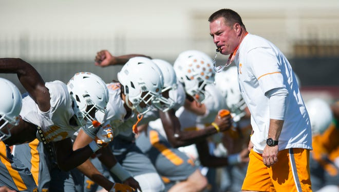 Coach Butch Jones blows his whistle during warmups at a Tennessee football preseason practice on Thursday, Aug. 18, 2016.