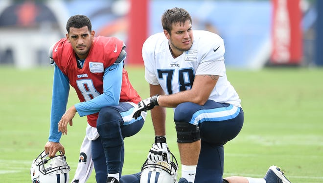 Titans quarterback Marcus Mariota (8) and offensive tackle Jack Conklin (78) watch during a joint training camp practice against the Carolina Panthers on Thursday, Aug. 17, 2017, at Saint Thomas Sports Park.