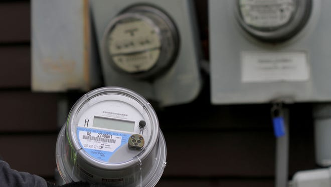 About 1.5 million DTE Energy customers and 330,000 Consumers Energy customers have advanced meters known as smart meters, like the one in the foreground. They help utilities track usage and solve demand issues.