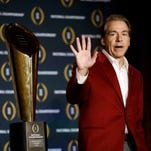 Alabama head coach Nick Saban poses with the championship trophy during a news conference for the NCAA college football playoff championship Tuesday, Jan. 12, 2016, in Scottsdale, Ariz. Alabama beat Clemson 45-40 to win the championship.
