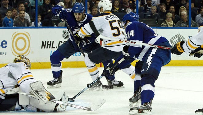 Tampa Bay Lightning right wing Brett Connolly (14) shoots as Buffalo Sabres goalie Michal Neuvirth (34) makes a save during the second period at Amalie Arena.