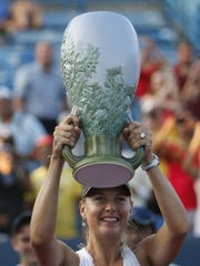 Maria Sharapova hoists the Rookwood trophy for winning The Western & Southern Open in 2011.
