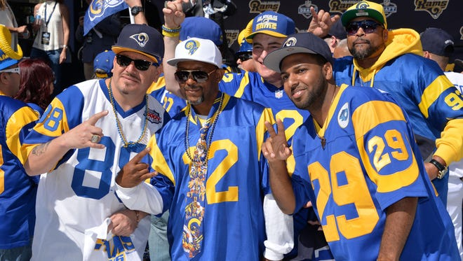 Los Angeles Rams fans pose at a 2016 NFL draft party at L.A. Live.