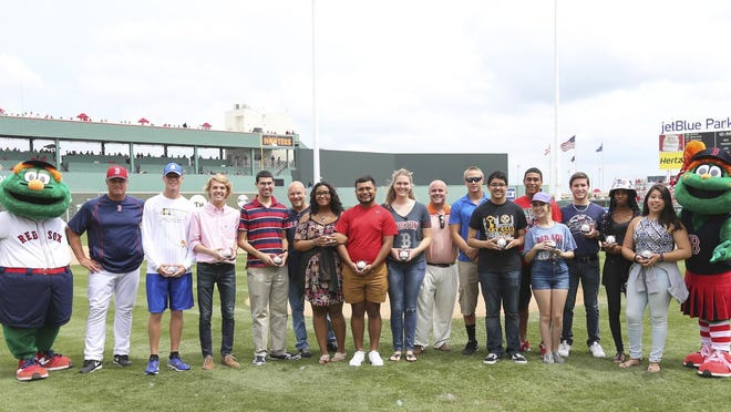 The first 13 recipients of Red Sox Foundation Scholarships awarded in Lee County are honored in a special pregame ceremony before a spring training game.