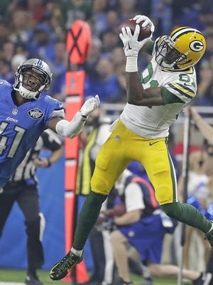 Green Bay Packers wide receiver Geronimo Allison (81) makes a long reception on against linebacker Jon Bostic (47) of the Detroit Lions at Ford Field Sunday, January 1, 2017.