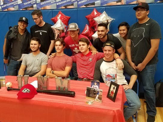 Las Cruces High's Tristin Lively, bottom second from