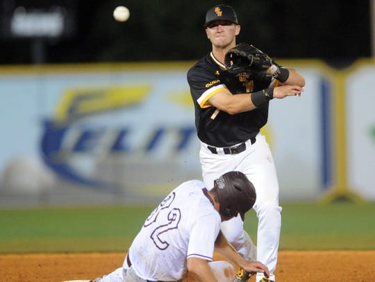 Southern Miss second baseman Matthew Guidry tags out