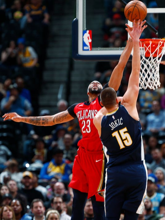 New Orleans Pelicans forward Anthony Davis, left, reaches up to block a shot by Denver Nuggets center Nikola Jokic, of Serbia, in the first half of an NBA basketball game Friday, Dec. 15, 2017, in Denver. (AP Photo/David Zalubowski)