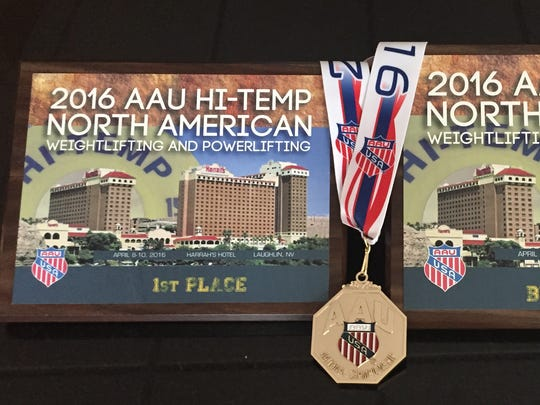 Some of the awards Ray Fougnier received in April 2016 for setting four world records at the Amateur Athletic Union's North American Powerlifting Championships in Nevada.