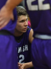 Spanish Springs' Jalen Townsell listens to the coach during a time-out during a recent game against McQueen.