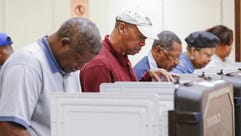 People participate in early voting in Decatur, Georgia,