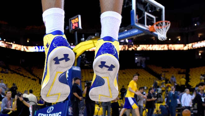 File photo taken in 2015 shows Under Armour's Curry One basketball shoes worn by NBA star guard Stephen Curry of the Golden State Warriors as he warmed up before taking on the Houston Rockets in game five of the 2015 Western Conference Finals.