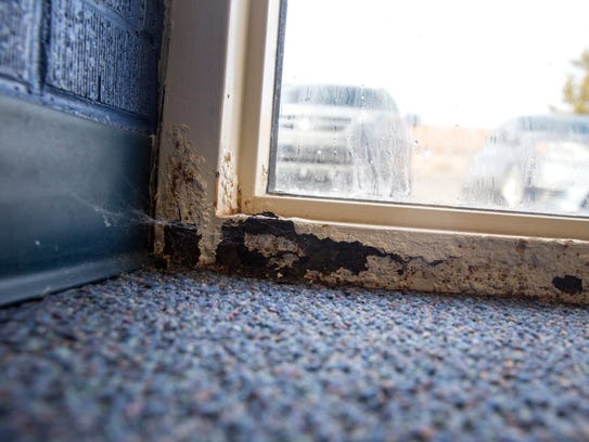 Deterioration and wear near a doorway is pictured on Friday at Country Club Elementary School in Farmington.