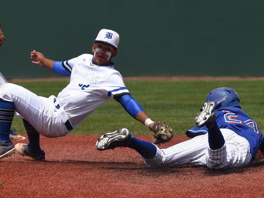 Basic's Christian Rivero reaches out to tag Reno's Joseph Condon as he slides into second base during the state playoff game at Bishop Manogue on May 17, 2018.
