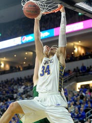 SDSU's Cody Larson dunks against NDSU's Dexter Werner during the Summit League men's basketball championship on Tuesday in Sioux Falls.