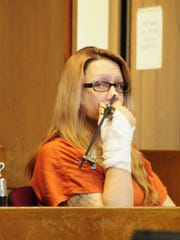 Theresa Marie Gafken, 36, waits for a hearing to begin