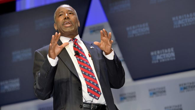 In this Sept. 18 file photo, Republican presidential candidate Ben Carson speaks in Greenville, S.C. Carson is refusing to back off his weekend charge that Muslims shouldn't serve in the presidency.