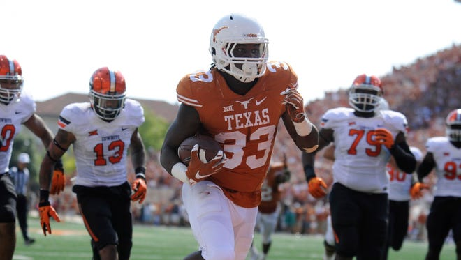 Texas running back D'Onta Foreman (33) cuts into the endzone against Oklahoma State on Saturday.