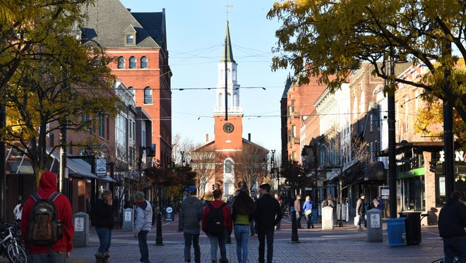 Shoppers walk along the Church Street Marketplace on November 11, 2014.