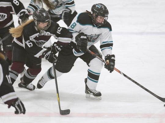 Bay Area's Megan Saari (8) handles the puck while being pursued by Central Wisconsin's Savannah Felch (15) during a game in February at Cornerstone Community Ice Center.