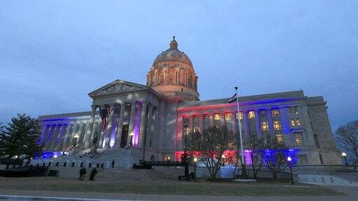 FILE - In this Monday, Jan. 9, 2017, file photo, lights shine on the Missouri Capitol as guests arrive for an inaugural ball in Jefferson City, Mo.