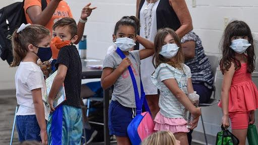 Children wear masks during the Anderson YMCA Day Camp in Anderson, S.C. Wednesday, July  29, 2020.