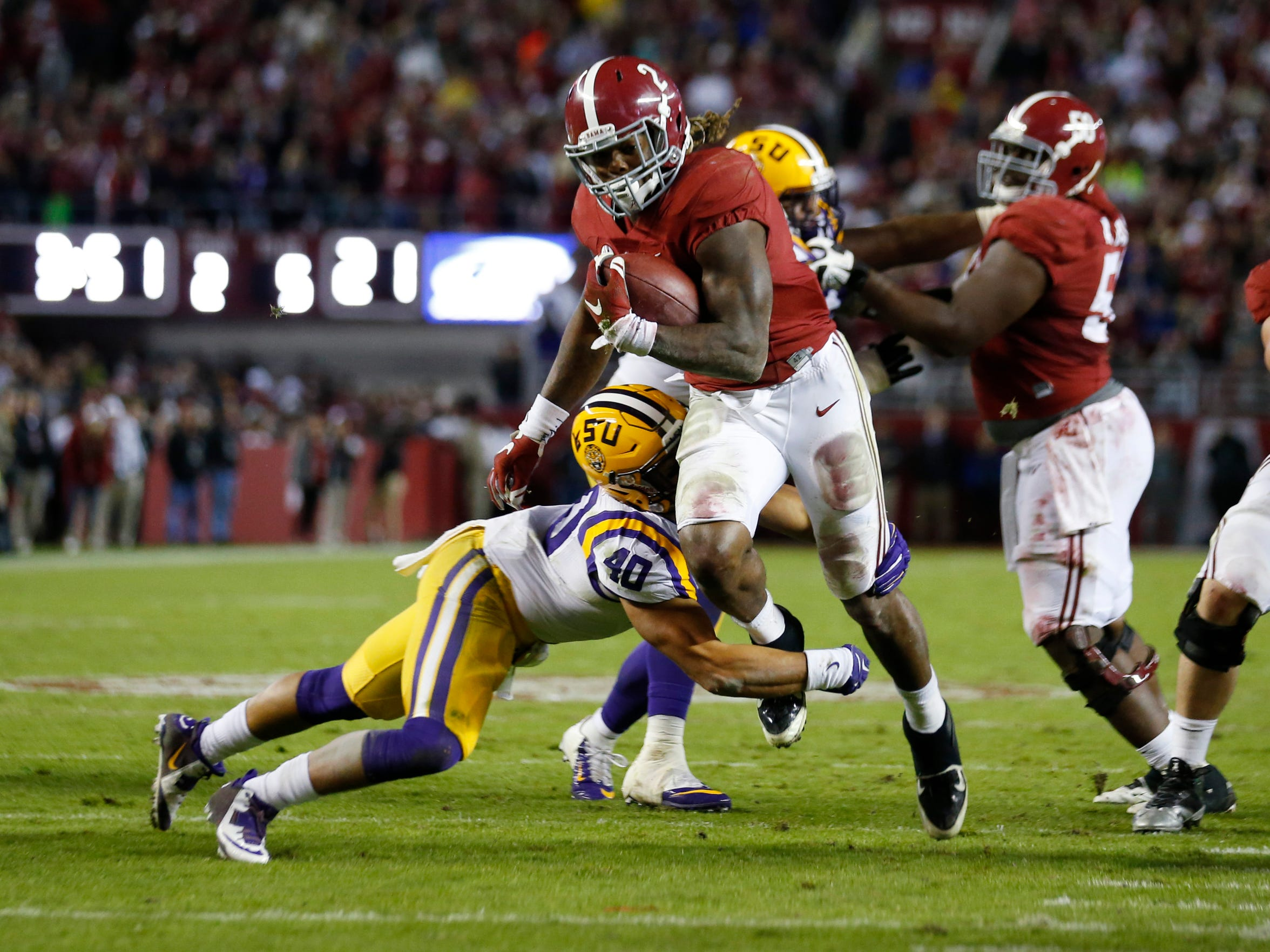 Alabama running back Derrick Henry is hit by LSU linebacker