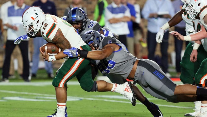 Miami quarterback Malik Rosier (12) is tackled by Duke defensive end Drew Jordan (86) in the first half at Wallace Wade Stadium.