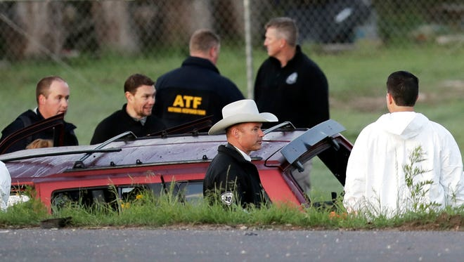 Officials investigate the scene where a suspect in a series of bombing attacks in Austin blew himself up as authorities closed in on March 21, 2018, in Round Rock, Texas.