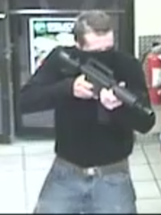 A robber wielding an AR style rifle made off with cash